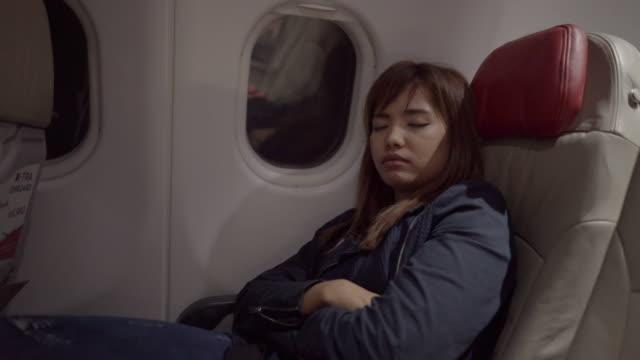 Woman Sleep on airplane