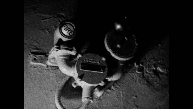 woman sleeping in cabin bed tu ship's 'fire' alarm light flashing porthole w/ smoke billowing crewman using phone woman sleeping smoke over alarm... - fire alarm stock videos & royalty-free footage