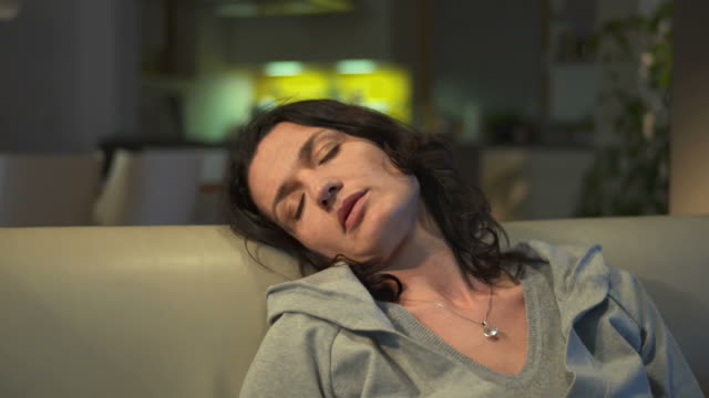 hd dolly: woman sleeping in front of a tv - exhaustion stock videos & royalty-free footage