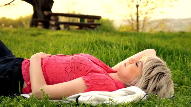 HD DOLLY: Woman Sleeping In Grass