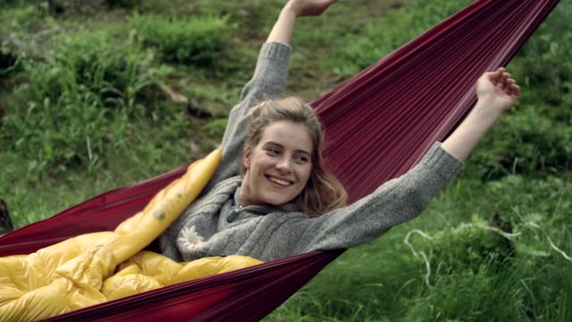 woman sleeping in hammock. outdoor relaxation - bush stock videos & royalty-free footage