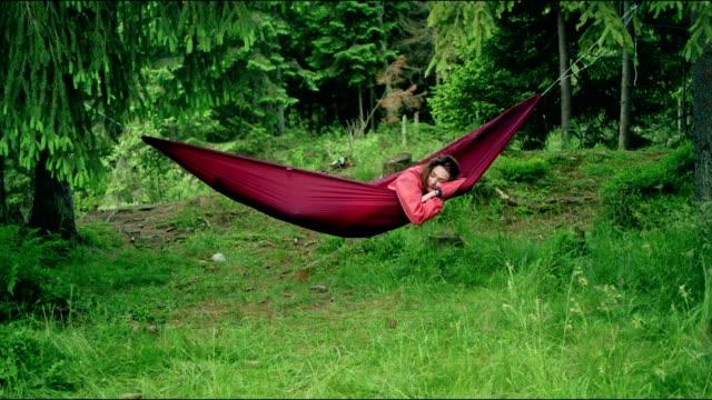 woman sleeping in hammock. outdoor relaxation - hammock stock videos & royalty-free footage