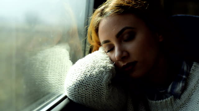 woman sleeping in train - ferrovia video stock e b–roll