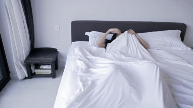 Woman sleeping moving from side to side
