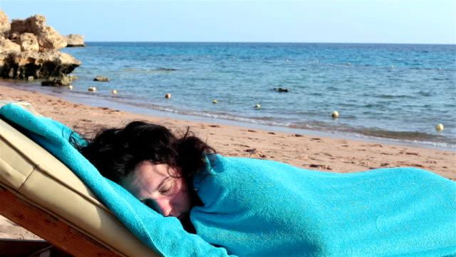 Woman sleeping on a deckchair.
