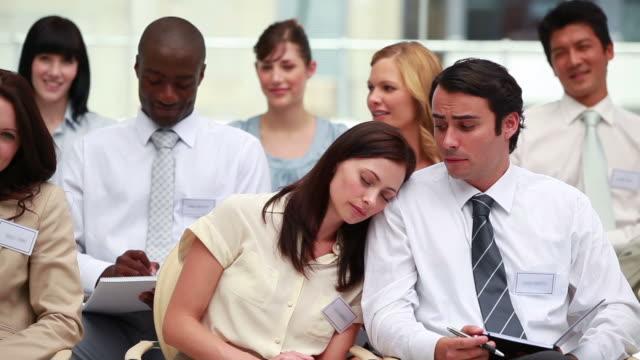 woman sleeping on the shoulder of her colleague - skjorta och slips bildbanksvideor och videomaterial från bakom kulisserna