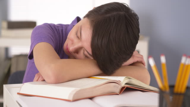 woman sleeping on top of books - feeding stock videos & royalty-free footage