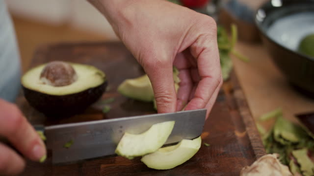 woman slicing avocado and putting it in blender at home - kitchen worktop stock videos & royalty-free footage