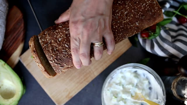 woman slicing bread - sour cream stock videos and b-roll footage