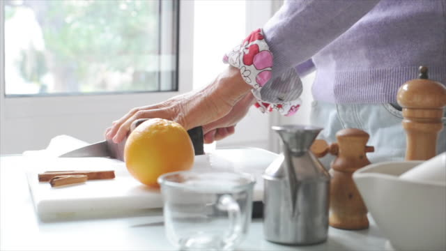Woman slicing fresh tuna