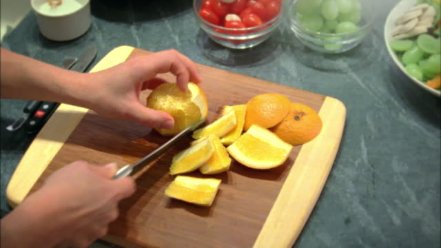cu woman slicing orange, new york city, new york, usa - citrus fruit stock videos & royalty-free footage
