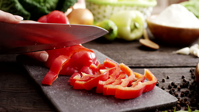 woman slicing pepper - chopped stock videos & royalty-free footage