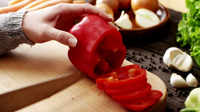 Woman Slicing Peppers
