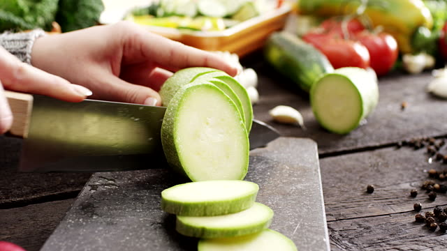 woman slicing zucchini - courgette stock videos and b-roll footage