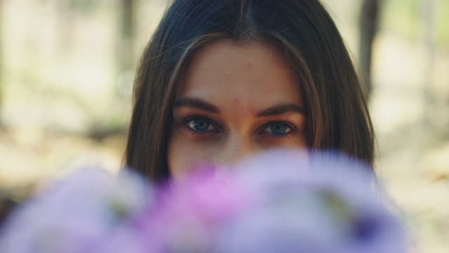 woman smelling at flowers - bunch stock videos and b-roll footage