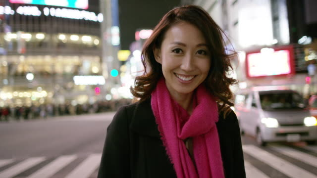ms a woman smiles and laughs to camera / tokyo, japan - only women stock videos & royalty-free footage