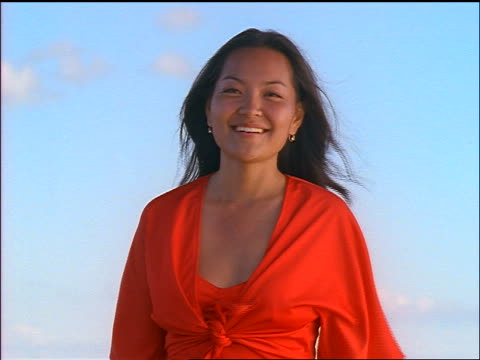 portrait woman smiling at camera outdoors / seagulls flying in background - pacific islander background stock videos & royalty-free footage