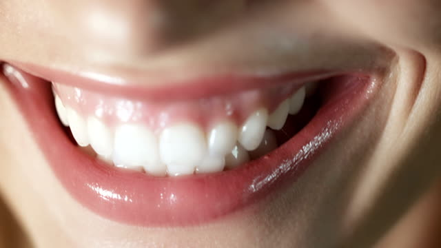 woman smiling closeup - teeth stock videos and b-roll footage