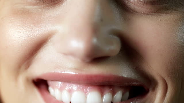 woman smiling closeup - human teeth stock videos and b-roll footage