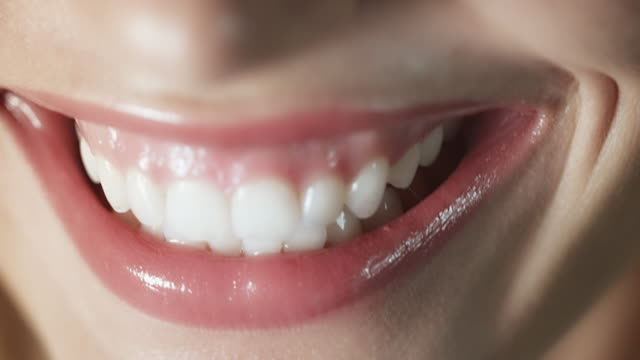 woman smiling closeup - human teeth stock videos & royalty-free footage