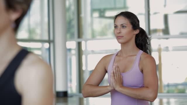 CU DS Woman smiling in yoga studio / Vancouver, British Columbia, Canada