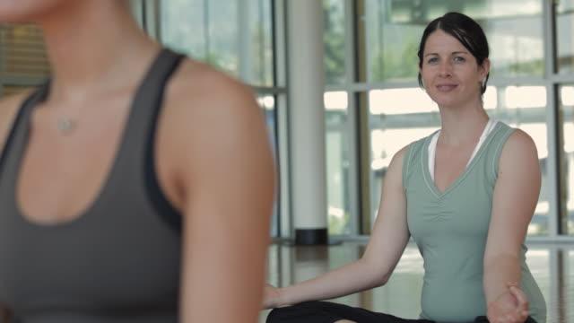 MS DS Woman smiling in yoga studio / Vancouver, British Columbia, Canada