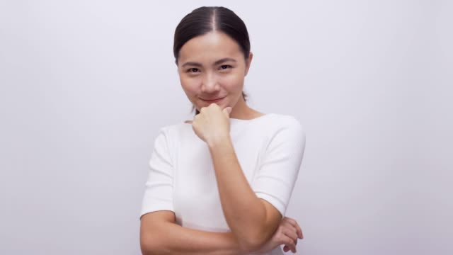 Woman smiling look at camera on isolated white background 4k