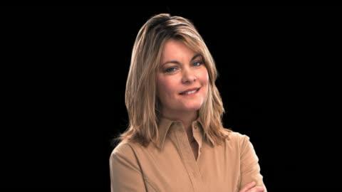 vídeos y material grabado en eventos de stock de woman smiling - this clip has an embedded alpha-channel - keyable