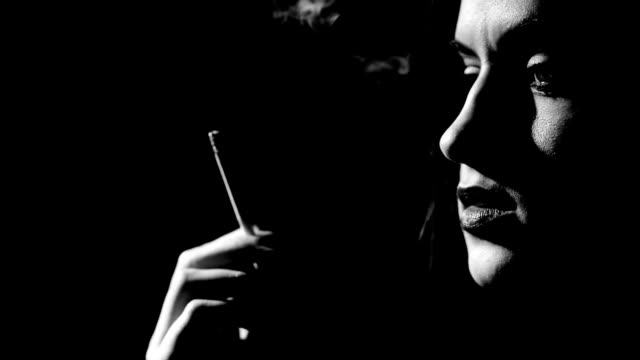 woman smoke cigarette - femme fatale stock videos and b-roll footage