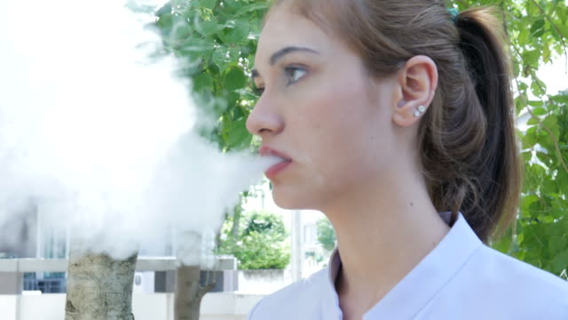 woman smoke e-cigarette - smoking issues stock videos & royalty-free footage