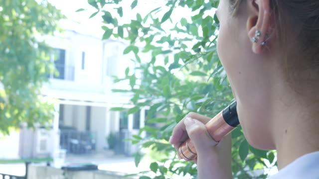 woman smoke e-cigarette