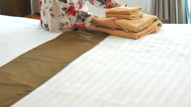 woman smoothing a fresh towel - service occupation stock videos and b-roll footage