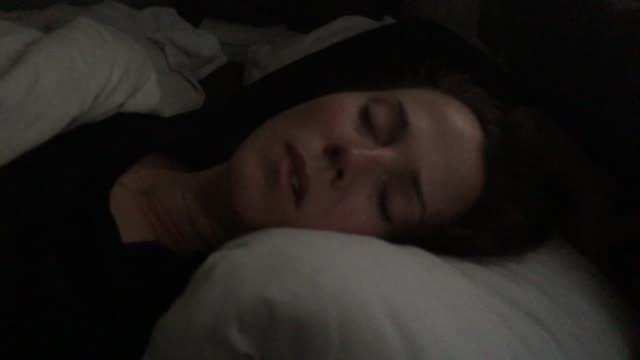 woman snoring in bed - snoring stock videos and b-roll footage
