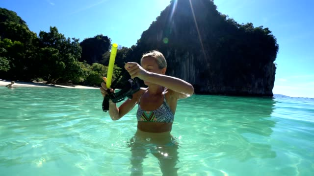 a woman snorkeling in the warm turquoise water of thailand - underwater diving stock videos & royalty-free footage