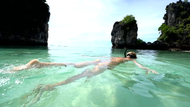 a woman snorkeling in the warm turquoise water of thailand - bay of water stock videos & royalty-free footage