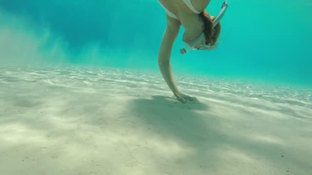 ms woman snorkeling underwater,grabbing handful of sand - croatia stock videos & royalty-free footage