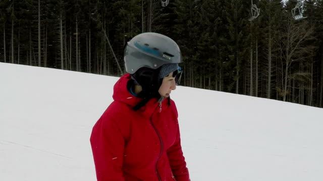 woman snowboarder rides on the ski slope. - ski jacket stock videos & royalty-free footage