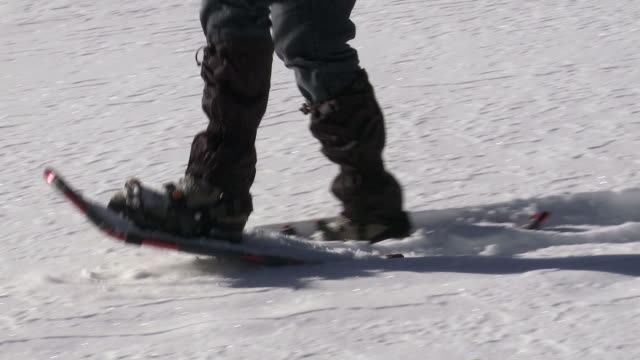 hd woman snowshoeing close-up - frau stock videos & royalty-free footage