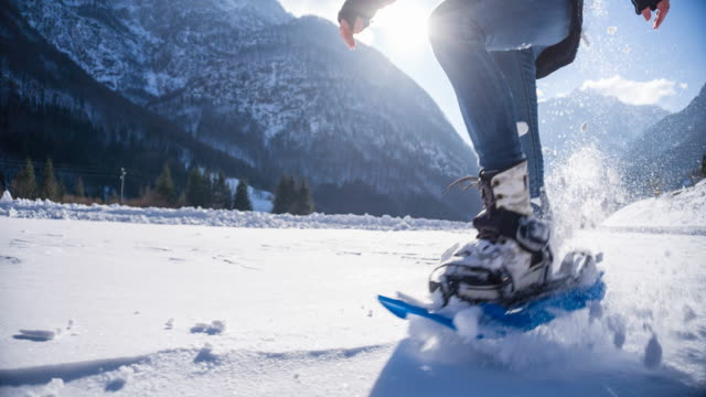 woman snowshoeing in winter landscape - skiing and snowboarding stock videos and b-roll footage