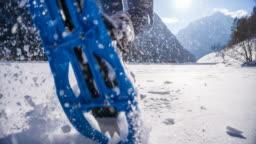 Woman snowshoeing on fresh snow