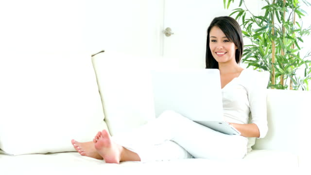 Woman social networking on a laptop