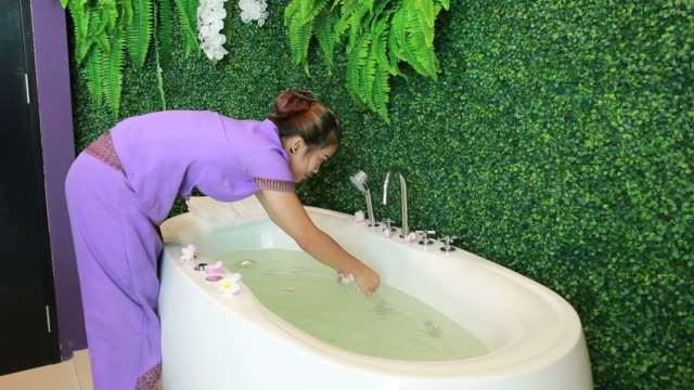 woman spa service decorating flower in hot tub bathtub - taking a bath stock videos and b-roll footage