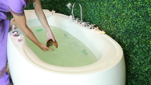 woman spa service prepare milk foam in hot tub bathtub
