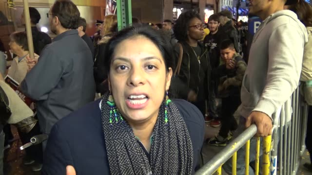 Woman speaking in the English language / Demonstrators protesting outside of the NBC Rainbow Room on Rockefeller Plaza / The ANSWER Coalition and the...