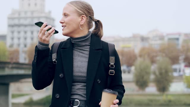woman speaking into smartphone, holding cup of coffee - blonde hair stock videos & royalty-free footage