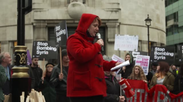 woman speaks during a stop the war coalition protest outside bbc world studios on december 12, 2015 in london, england. stop the war coalition is... - war stock-videos und b-roll-filmmaterial