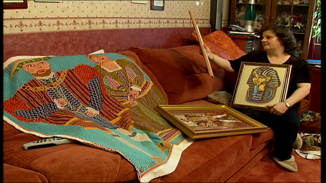 woman spends 20 years recreating the bayeux tapestry england london finchley int annette banks sitting on sofa in living room and holding up framed... - tapestry stock videos & royalty-free footage
