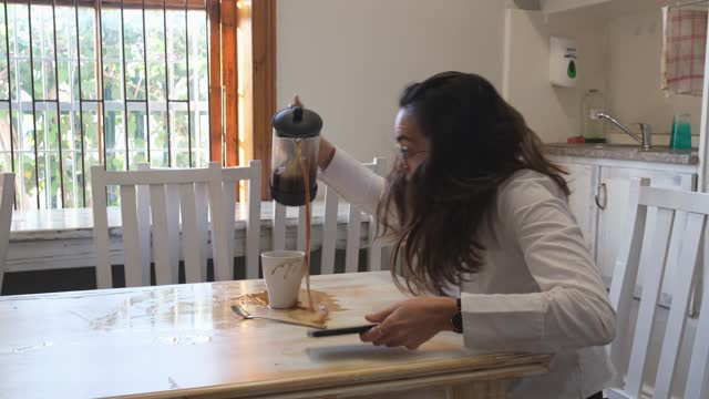 woman spills coffee all over the table while at work - blooper film clip stock videos & royalty-free footage