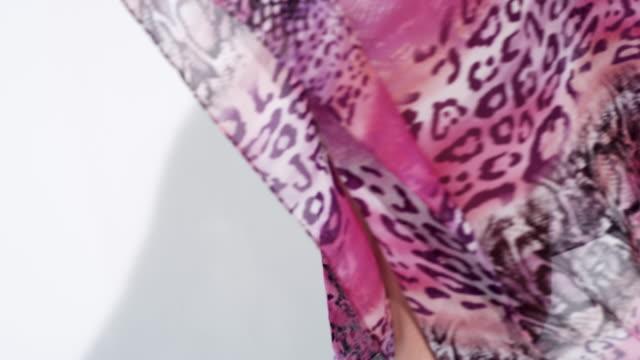 woman spinning around revealing her body through translucent pink kaftan - translucent stock videos & royalty-free footage