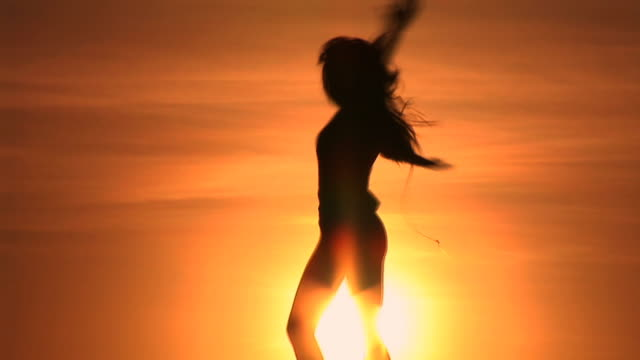 HD: Woman Spinning At Sunset